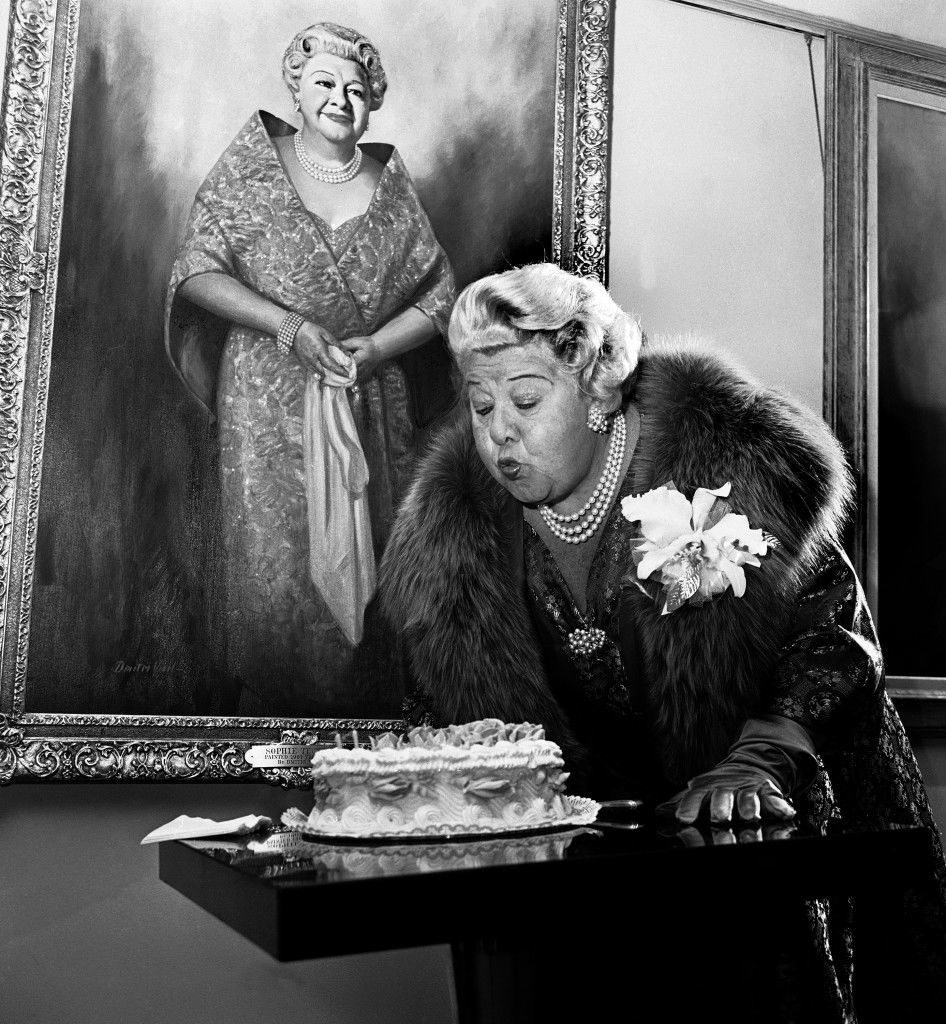 Singer Sophie Tucker blows out the candles on a birthday cake as she celebrates her 74th birthday in Dallas, Jan. 13, 1962. Behind her hangs a painting by Dallas artist Dmitri Vail which she saw finished for the first time. (AP Photo/Ferd Kaufman) Ref #: PA.12587669