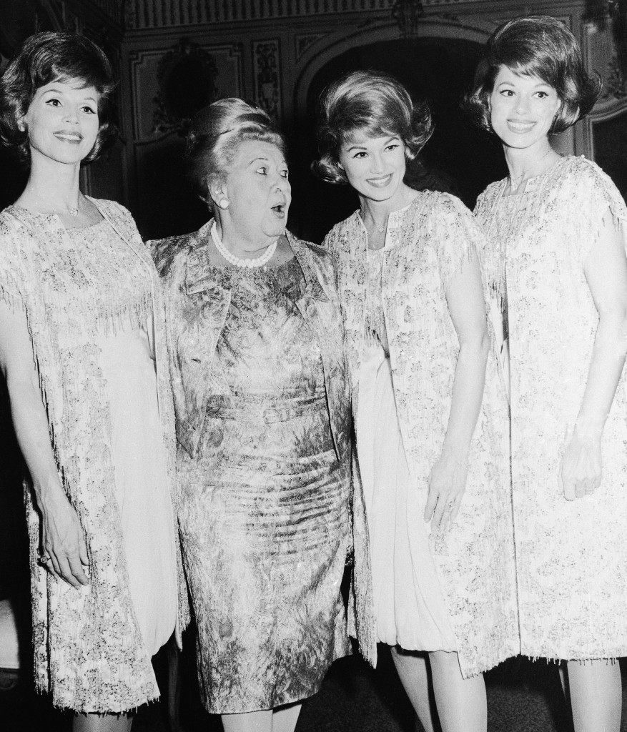 "Sophie Tucker whose fame didn't exactly rest on Mozart or Verdi arias, agreed to give youth a plug when she posed with the singing McGuire Sisters, Christine, Phyllis and Dorothy after their debut at the Plaza's Persian room, April 24, 1964. Sophie, commonly known as ""The Last of the Red Hot Mamas"", was on hand along with other celebrities to welcome the swinging sisters to New York. (AP Photo/Matty Zimmerman) Ref #: PA.12587683"