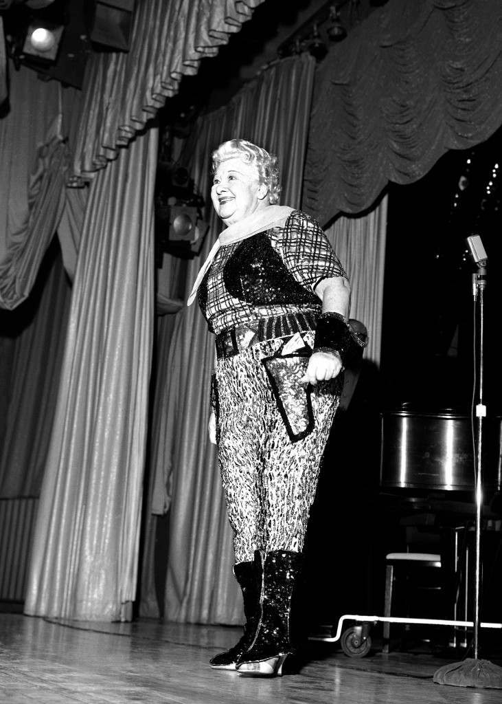 In an outfit with slight Wild Western influences, Sophie Tucker laments the state of TV's Western heroes in her new night club act in Las Vegas, Nev., Feb. 13, 1959. The veteran star is still quick on the draw with salty quips. (AP Photo) Ref #: PA.12587696  Date: 13/02/1959