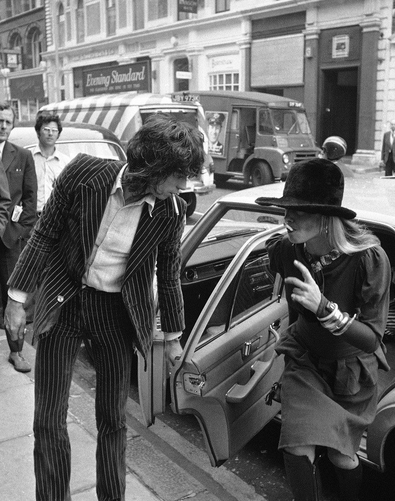 Keith Richards, from The Rolling Stones, 29, accused of drugs and firearm charges, opens the door of car for girlfriend, actress Anita Pallenberg, 31, also charged with possessing drugs, on arrival at Marlborough Street Court in London, England on June 27, 1973. Richard was later freed on £1,000 bail. (AP Photo/Robert Rider Rider) Ref #: PA.12870569