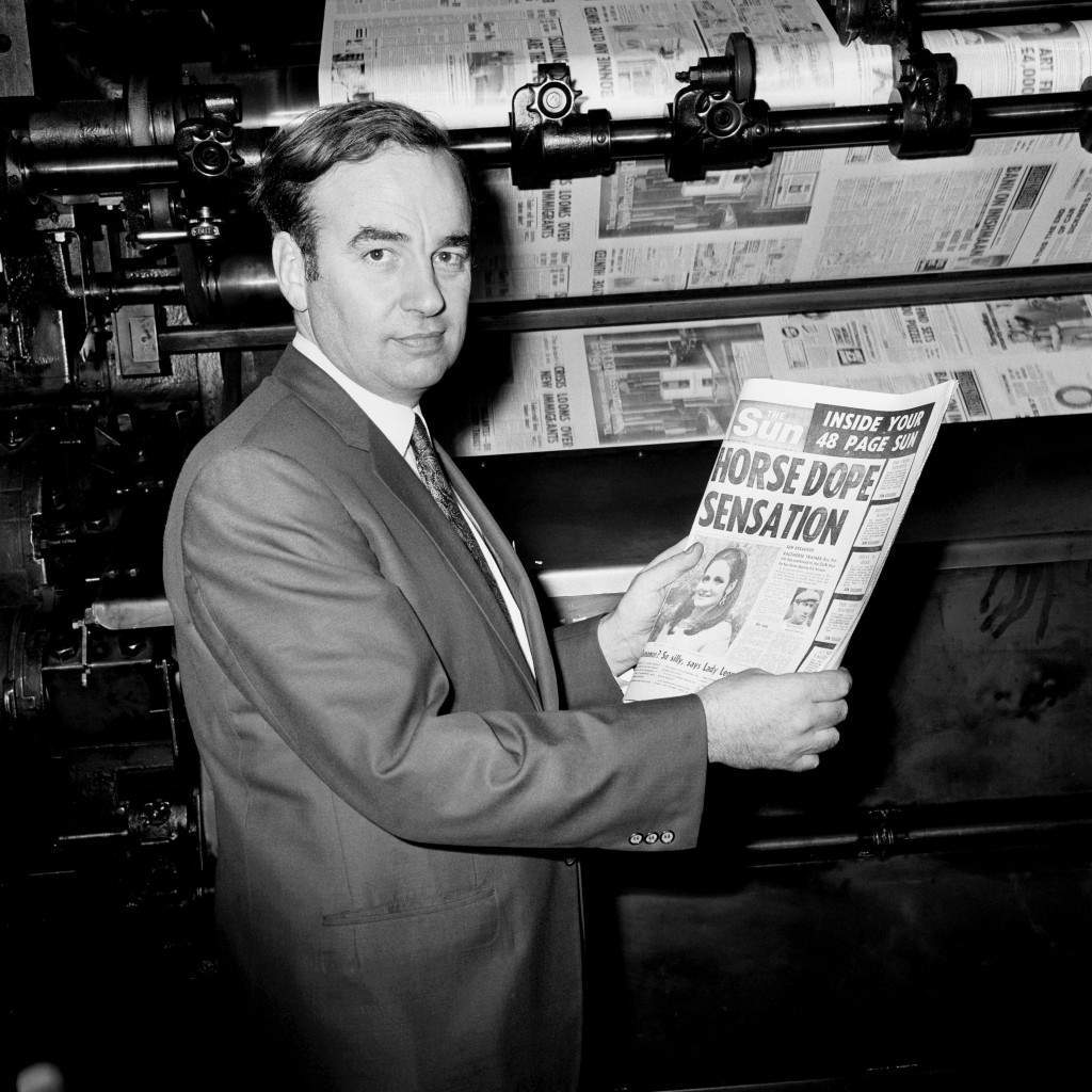 e picture, dated 17/11/1969, Rupert Murdoch looks at one of the first copies of The Sun newspaper, at the News of the World building , in London.
