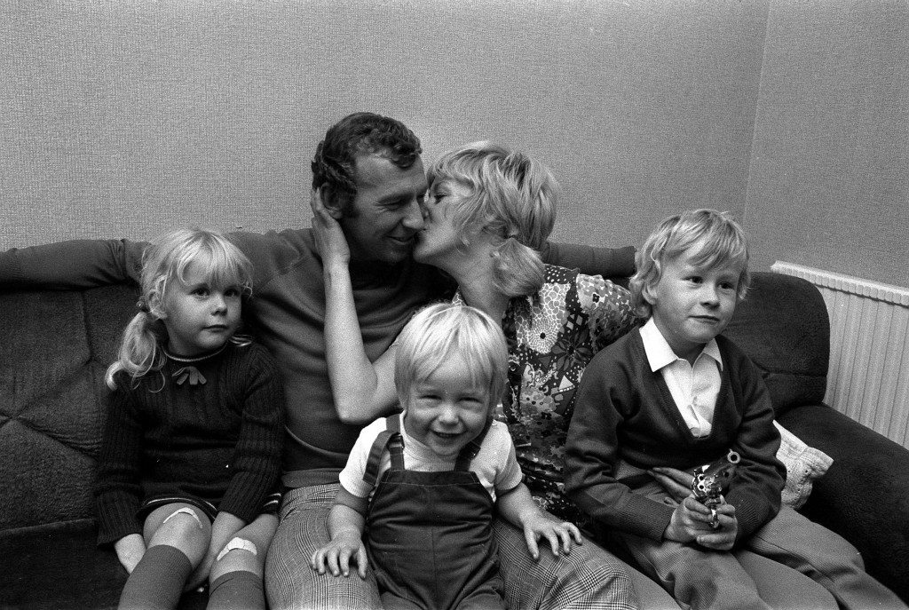 BOB WILSON 1971: Arsenal goalkeeper Bob Wilson gets a kiss from his wife, Megs, after being named in Scotland's party of 16 for the European Championship match against Portugal. With them are Anna (4), Robert (2) and John (6). New rules allow players to represent their parents' country. Ref #: PA.1352991  Date: 04/10/1971