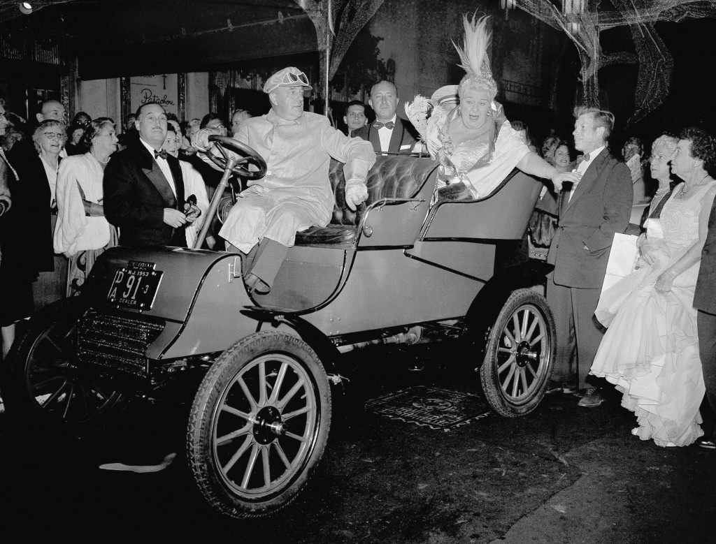 "Sophie Tucker, famous entertainer known as ""The last of the Red Hot Mamas,"" makes her arrival at golden jubilee dinner in her honor in 1903 ford ""Flivver"" Oct. 4, 1953 at Waldorf Astoria Hotel, New York City. Driver is Eldred Crowe, of Westfield, New Jersey dressed in gold duster. (AP Photo/TF) Ref #: PA.14466244"
