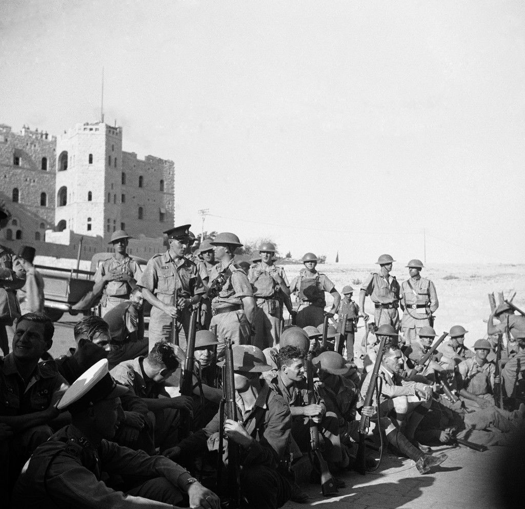 British captors of Old Jerusalem await fresh military orders ourside the Damascus Gate through which they penetrated the lines of the Arab rebels. (AP Photo/James Mills) Ref #: PA.14567790 Date: 31/10/1938