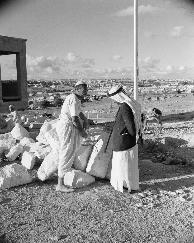 Two Arabs chat by the roadside with the ancient city of Jerusalem in the background, Nov. 28, 1947. (AP Photo/Jim Pringle) Ref #: PA.14713577 Date: 28/11/1947