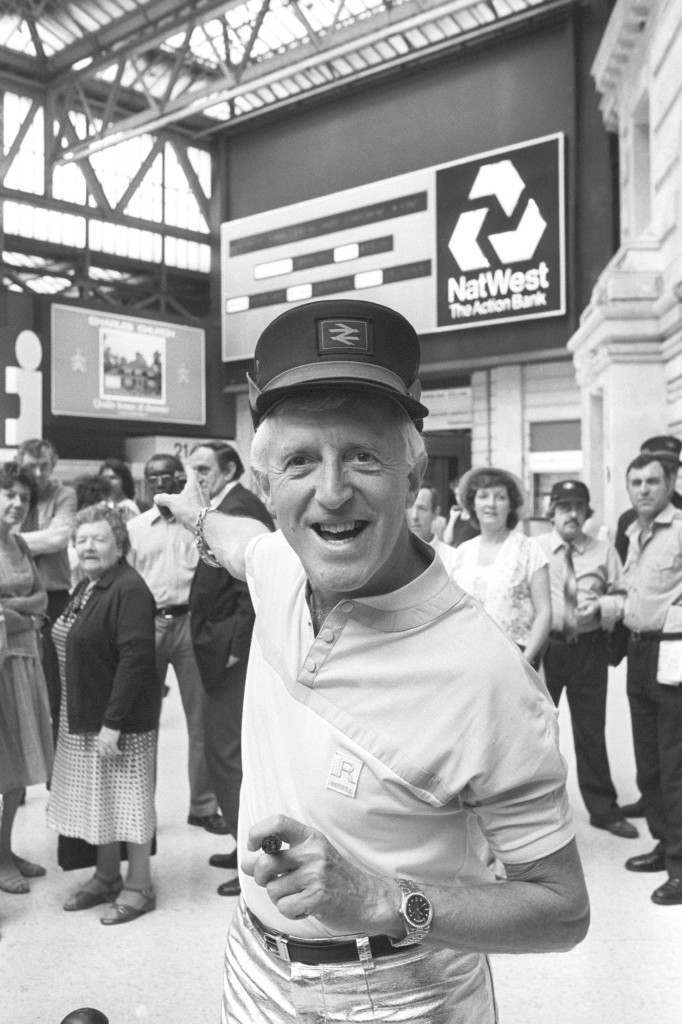 DJ Jimmy Savile at Waterloo Station, where he launched Natwest's news sign, which displays the latest world and national updates, city prices and weather. Archive-PA210376-1 Ref #: PA.14859132  Date: 20/06/1984