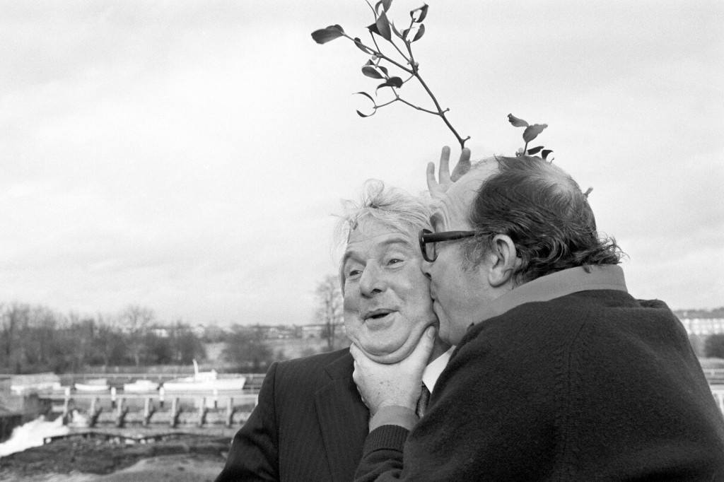 Comedy duo Eric Morecambe, right, and Ernie Wise with mistletoe at Thames Television's Teddington studios in London. Archive-PA190711-2 Ref #: PA.14906605  Date: 09/12/1979
