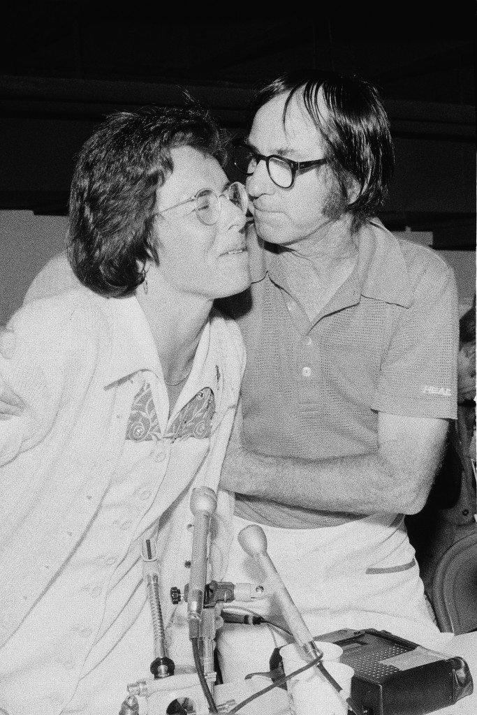 Bobby Riggs, right, leans over to plant a kiss on Billie Jean King after Ms. King set Riggs down 6-4; 6-3; 6-3 in their $100,000 winner-take-all tennis match in the Astrodome in Houston, Tex., Thursday, Sept. 21, 1973. (AP Photo) Ref #: PA.14925068  Date: 21/09/1973