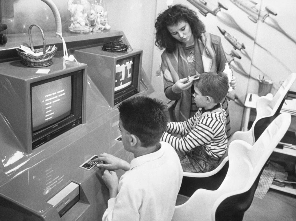 At a hairdressing salon in Colmer in the Alsace region of eastern France, Jean-Jacques Henry can't keep the children away since he installed video computer games to keep them amused while undergoing a hair cut. Archive-PA231846-1 Ref #: PA.15216886  Date: 12/05/1989