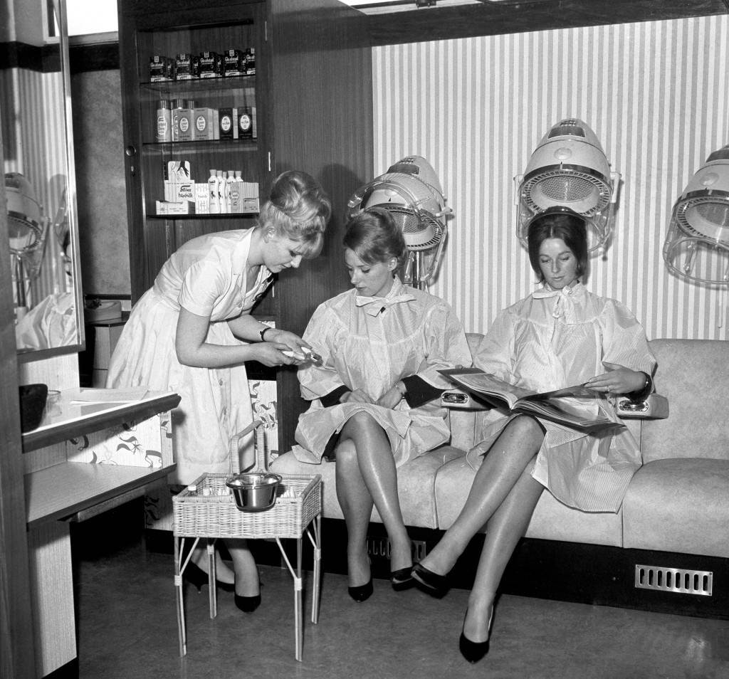Mary Rahilly (centre) and Helen Richardson (right), enjoy a hair salon exclusively for the use of British European Airways staff at London Heathrow Airport. Archive-pa109624-1 Ref #: PA.15216966  Date: 27/04/1964