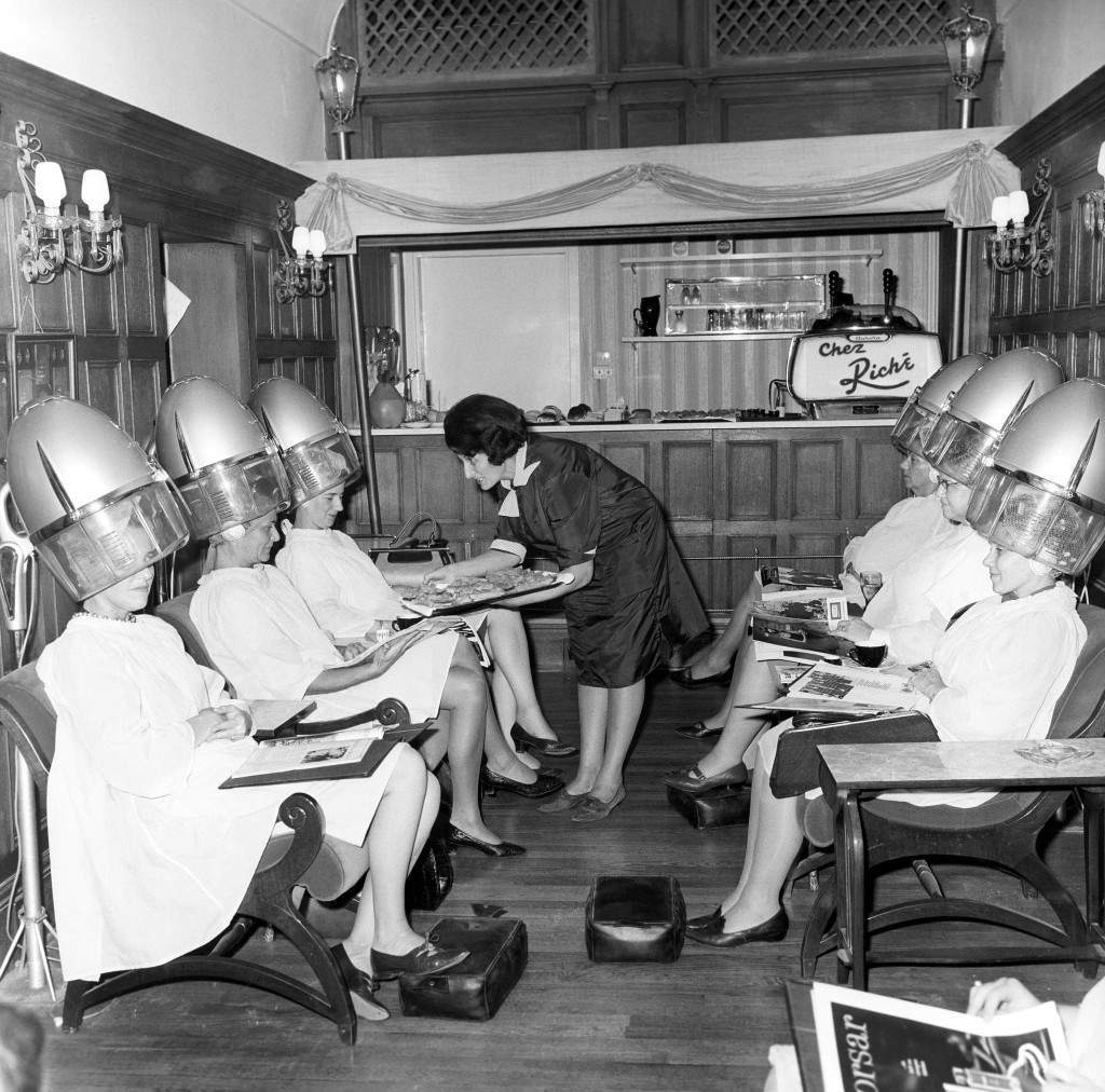 Six American women stop off at a hairdressers during a tour of London. They are part of a coach-load of 60 women who visited the Riche salon in Mayfair during their sightseeing trip. Archive-pa124701-1 Ref #: PA.15216967 Date: 14/10/1966