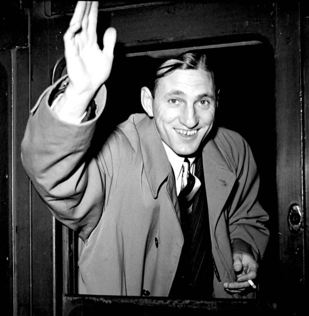 For the third time since the war a M.C.C. team left for a Test tour, this time against South Africa. Len Hutton, the Yorkshire player, waving a cheery farewell from the boat-train at Waterloo station before the M.C.C. Team left for Southampton. Ref #: PA.1632095  Date: 07/10/1948