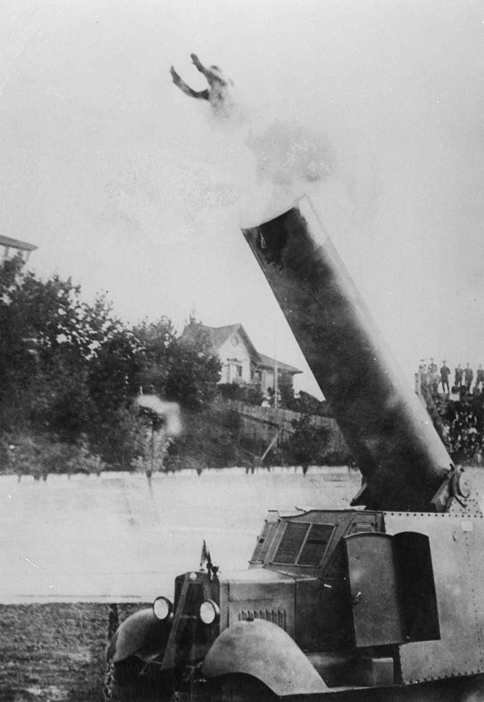 Hugo Zacchini of Turin, Italy, is shot from a specially built cannon invented by his brother, July 19, 1927. He landed in a net about 130 feet away. (AP Photo) Ref #: PA.16860983  Date: 19/07/1927