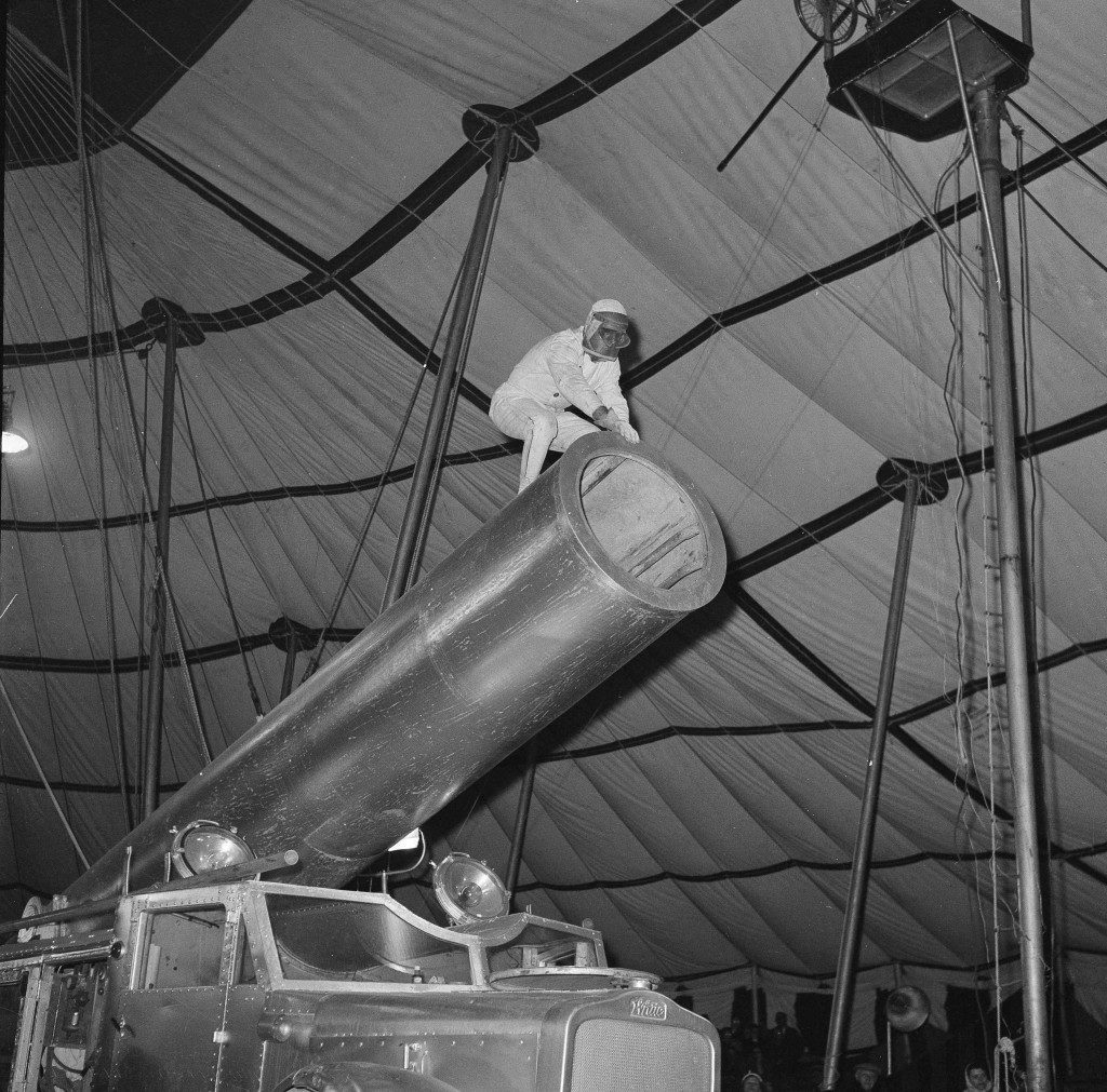 """Circus star G. Hugo Zacchini, famous for 30 years as """"The Human Cannonball"""", prepares to climb into the mouth of his cannon during his act in a circus at Palisades Park, N.J., April 11, 1958. Zacchini, who is shot into space twice a day, now is billed as """"The Human Satellite."""" The altered billing reflects his new aim in life - a trip in a rocket. Zacchini is convinced that only a cannon man, used to looking upon life as a bore, is mentally and physically equipped for a space journey. (AP Photo/Matty Zimmerman) Ref #: PA.16860991  Date: 11/04/1958"""