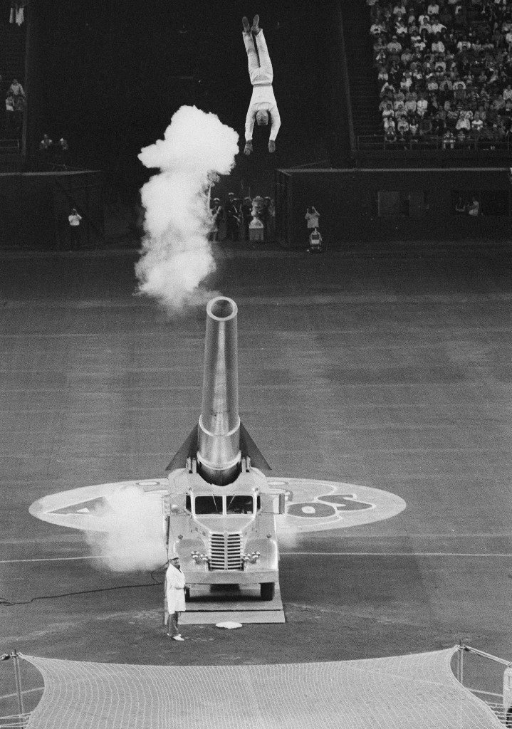 Stuntman Hugo Zacchini (top) is shot out of a cannon into a net (bottom) to deliver the first ball in Houston's Astrodome, April 8, 1977. It was the season opener for the Houston Astros and the Atlanta Braves. (AP Photo/JKW) Ref #: PA.16860992