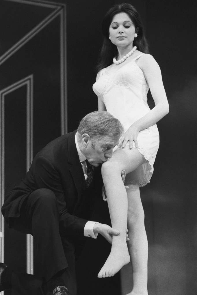 Sir Alec Guinness kisses the knee of Madeline Smith during a rehearsal of Alan Bennett's Habeas Corpus at the Lyric Theatre. Ref #: PA.17130443  Date: 09/05/1973