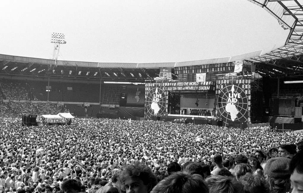 A general view of Wembley stadium with the guards band playing the National Anthem on the arrival of the Prince and Princess of Wales who opened the Live Aid concert. PA-1880417