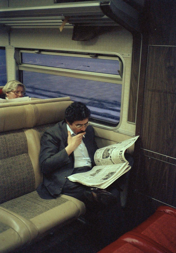 A commuter on a Metro-North train smokes during rush hour in Dobbs Ferry, N.Y., Feb. 13, 1988. Beginning Monday, passengers on the MTA's commuter lines will no longer provide special smoking cars and smoking will be prohibited. The commuters, backed by the nation's largest cigarette company, are challenging the prohibition in court. (AP Photo/Sam Heiman) Ref #: PA.17634104  Date: 13/02/1988