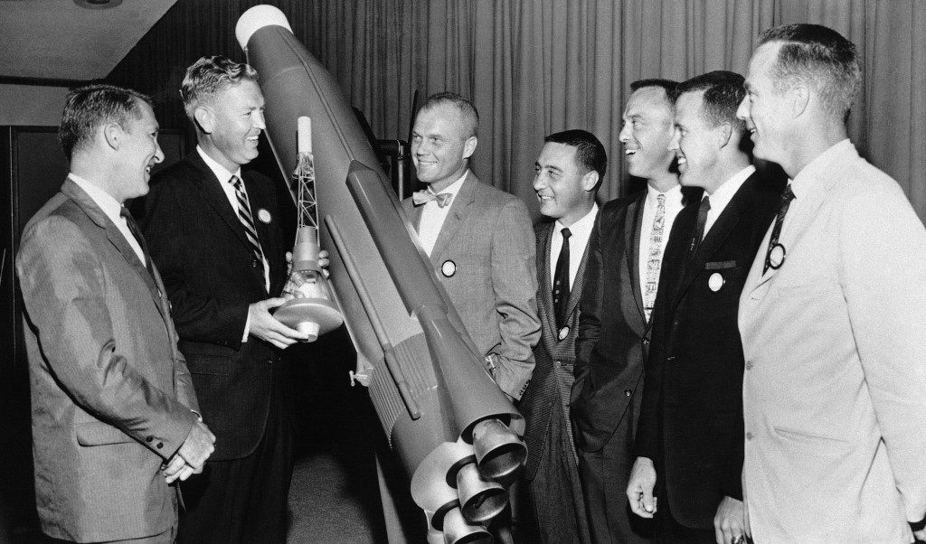 In this photo taken Sept. 25, 1959 in San Diego, California, U.S. astronauts laugh while standing around models of the Atlas and nose capsule designed to carry them into space. From left are Walter Schirra, J.R. Dempsey, executive of Convair, maker of Atlas, John H. Glenn, Jr., Virgil I. Grissom, Alan Shepard, Leroy G. Cooper Jr. and Malcolm S. Carpenter. RR Auction of Amherst, N.H. is auctioning off a letter Grissom wrote to his mother, how he and five of his fellow Mercury 7 astronauts resented John Glenn for getting the nod to be the first American to orbit the earth. (AP Photo/FILE) Ref #: PA.18266821