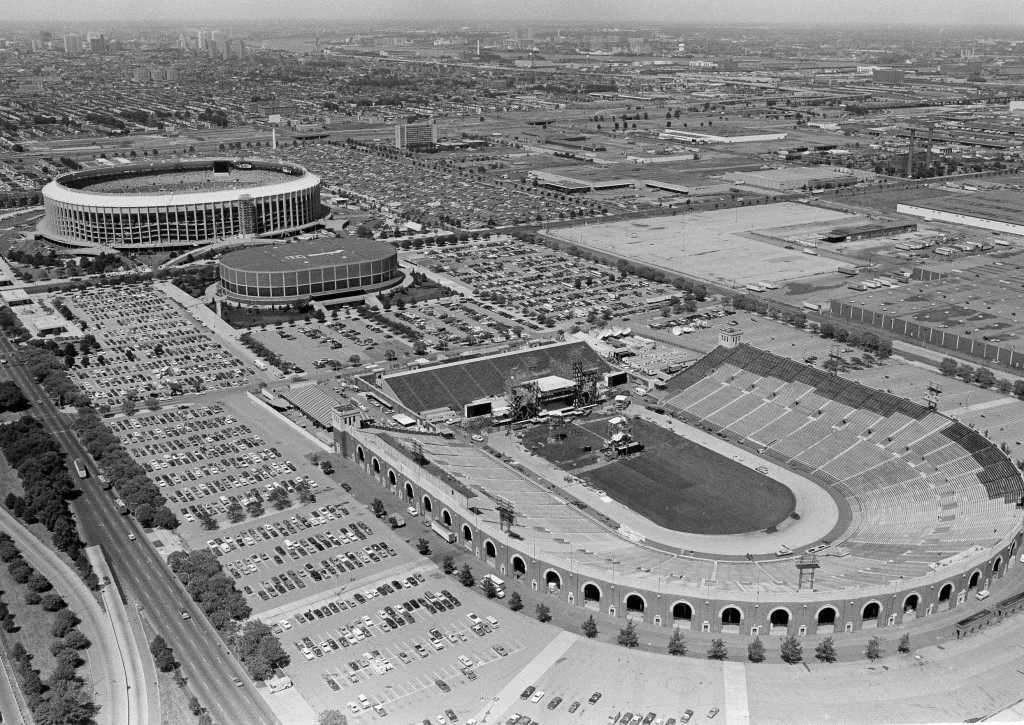 This aerial view Live Aid Concert from the Good Year blimp shows Philadelphia's J.F.K. Stadium, July 12, 1985, foreground, which will be the site of Live Aid Concert. In the background are, from left, veterans Stadium and the Spectrum. (AP Photo/George Widman) PA-18317495