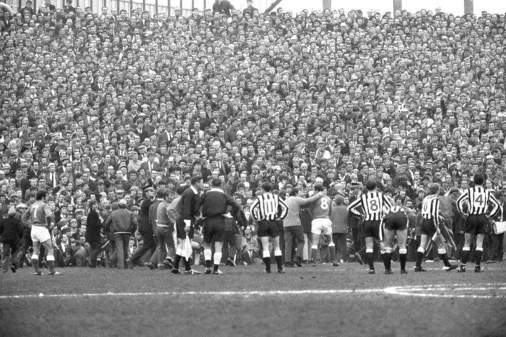 Soccer - Inter-Cities Fairs Cup - Semi-Final 2nd Leg - Newcastle United v Rangers - St James' Park Some members of the crowd are seen on the pitch following an incident between Newcastle's Davies and Rangers' McKinnon. Twenty-two people were taken to hospital with injuries after fighting broke out on the field. Ref #: PA.18756907  Date: 21/05/1969