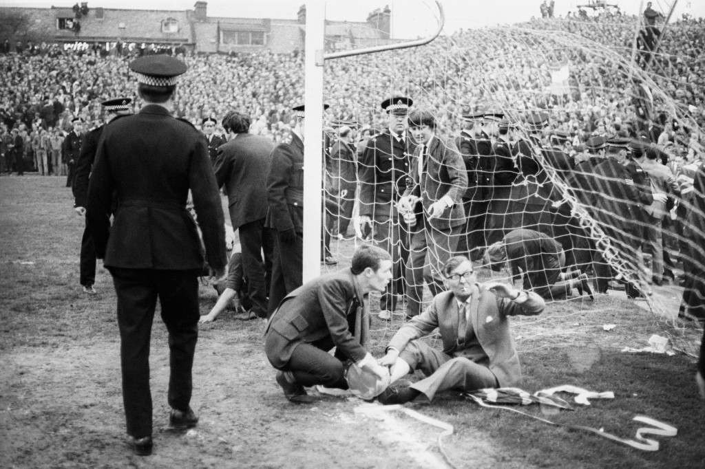 Soccer - Inter-Cities Fairs Cup - Semi-Final 2nd Leg - Newcastle United v Rangers - St James' Park Injured spectators are treated on the pitch after violence broke out at the Fairs Cup semi-final match. Twenty-two people were taken to hospital with injuries. Ref #: PA.18756908  Date: 21/05/1969