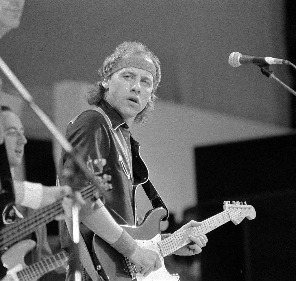 Leader of Dire Straits rock band, Mark Knopfler performs at the Live Aid concert.  PA-1930693
