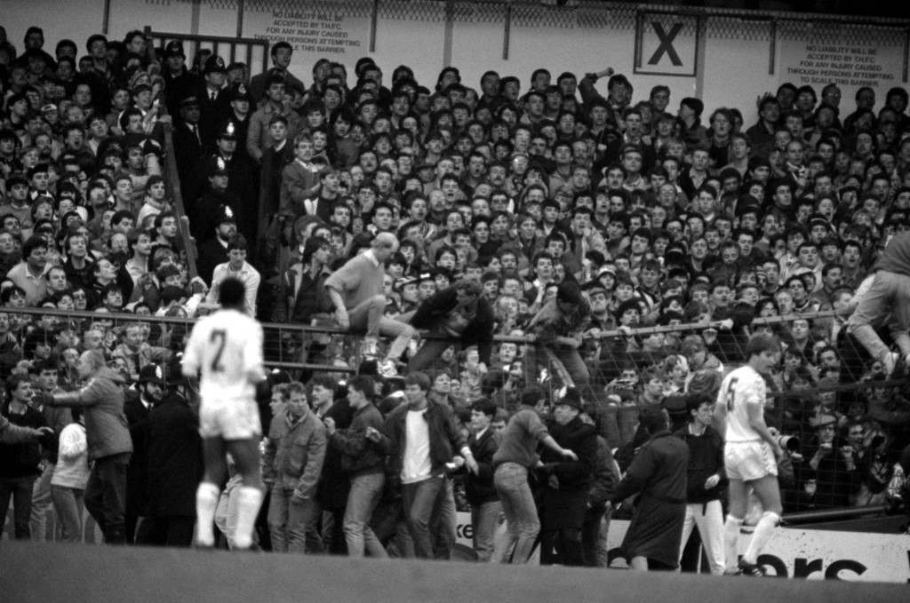 Newcastle United supporters climb the barriers at White Hart Lane as police help to clear the packed stands to prevent injury during the FA Cup Fifth Round match. Ref #: PA.2012127  Date: 21/02/1987