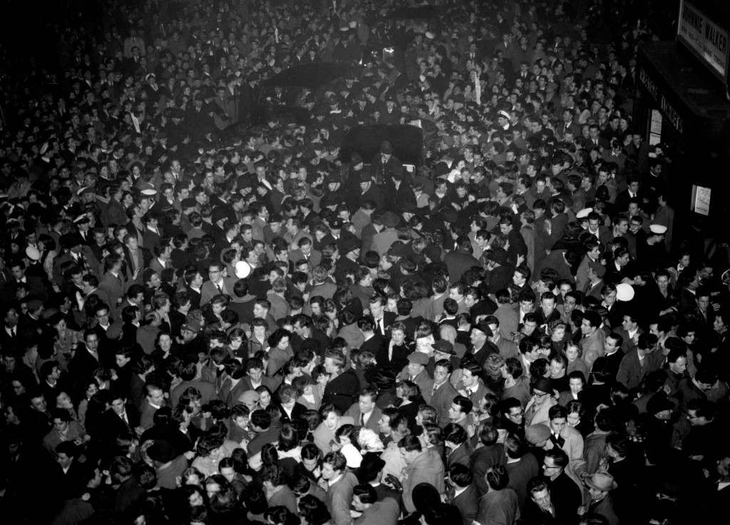 Crowds gather outside the Dominion Theatre in Tottenham Court Road, London, where Bill Haley & His Comets are playing. Ref #: PA.20472038  Date: 06/02/1957