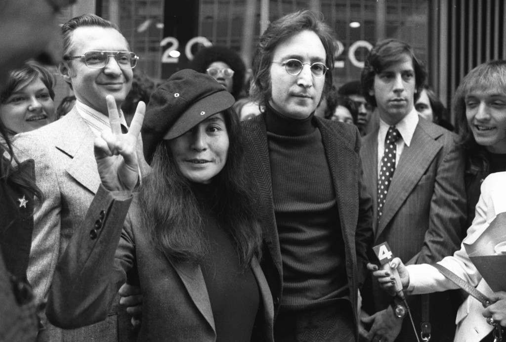In this April 18, 1972, file photo, John Lennon and his wife, Yoko Ono, leave a U.S. Immigration hearing in New York City. The argument over President Barack Obama's legal authority to defer deportations begins 42 years ago with a bit of hashish, a dogged lawyer and, yes, John Lennon and Yoko Ono. Lennon was facing deportation from a Nixon administration eager to disrupt the ex-Beatle's planned concert tour and voter registration drive. The case hinged on Lennon's 1968 conviction for possession of cannabis resin in London. Lennon ultimately succeeded. The case's legacy is an integral part of the legal foundation Obama relied on in 2012 to set up a program that has deferred the deportation of more than 580,000 immigrants who entered the country illegally as children. (AP Photo)