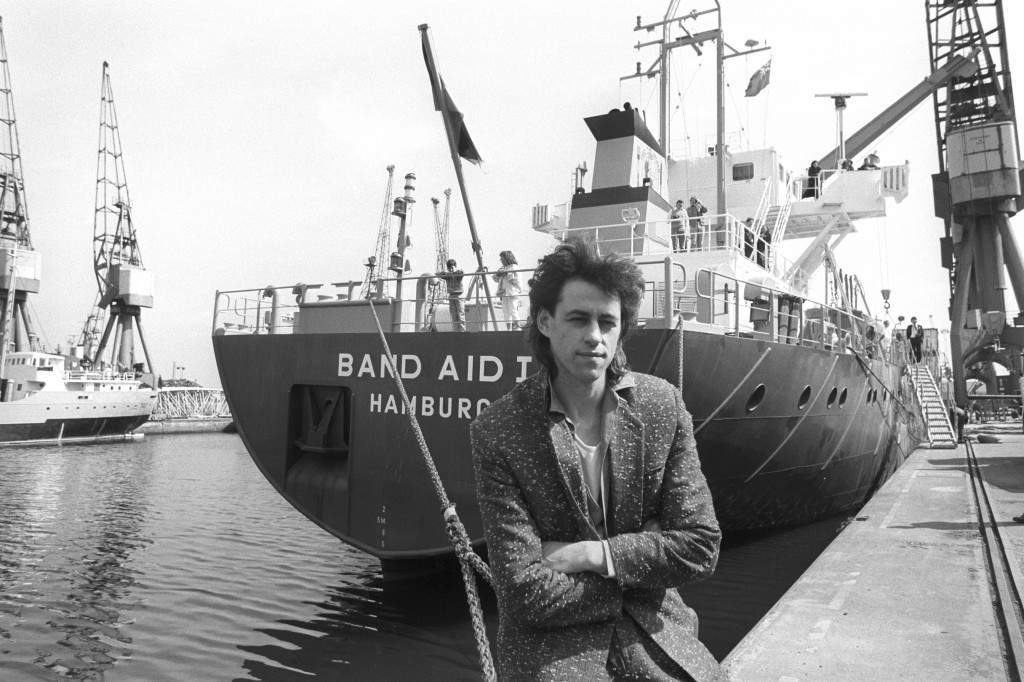 Pop star Bob Geldof on the quay at Tilbury before a re-named freighter, Band Aid I, sails for the Red Sea ports of Port Sudan and Assab. Band Aid, the group founded by Geldof to aid famine-stricken people of Ethiopia, is sponsoring a free-freight shipping service to take relief supplies to drought areas of the country. PA-20990442