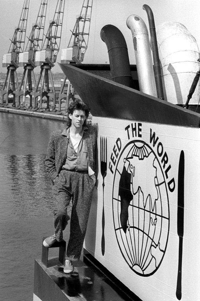 Pop star Bob Geldof stands on the ship, Band Aid I, by a funnel painted with a poignant message at Tilbury docks before the ship sailed with its cargo of relief supplies for famine-stricken Ethiopia.PA-20990443
