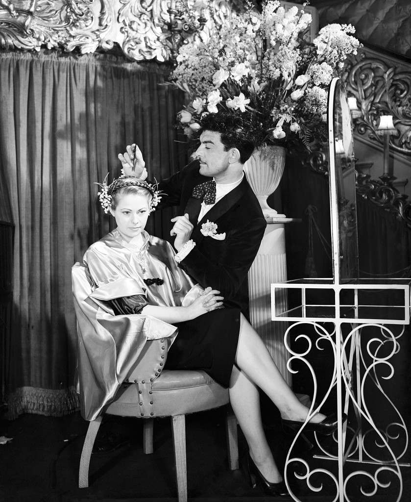 Raymond deftly works on a coiffure shown in his Easter Parade of 1951 hairstyle at Care de Paris, Coventry Street, London. He calls it 'Easter Parade' and has miss Stella Cribe as his model. 559-archive-pa28291-3 Ref #: PA.21021010  Date: 15/03/1951