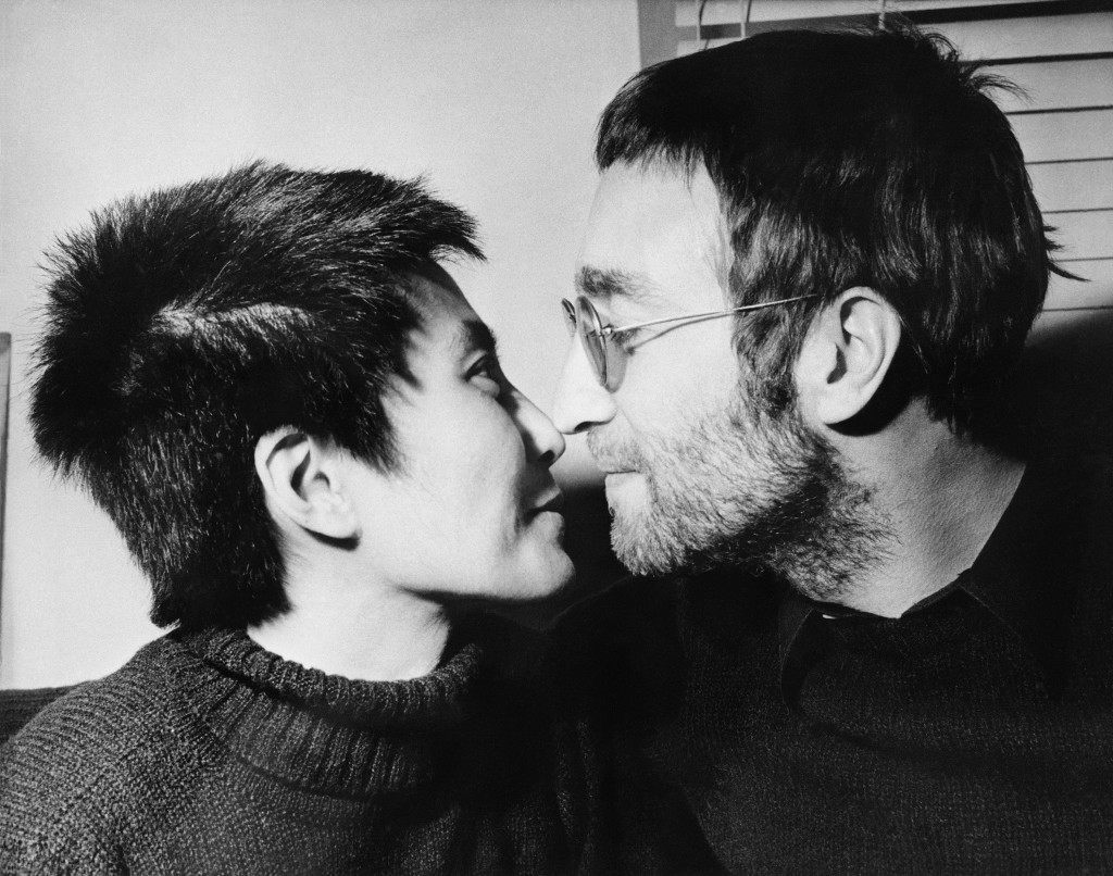 John Lennon and his wife Yoko Ono share an Eskimo kiss (rubbing noses) during an interview in London, Feb. 9, 1970. Both had their hair shorn in Denmark to be auctioned off in London. The proceeds will go to the Black Power organization in Britain. (AP Photo/Bob Dear) Ref #: PA.21116740  Date: 09/02/1970