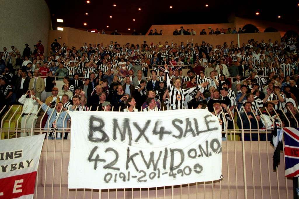 SOCCER - UEFA CUP QUARTER FINAL - AS Monaco v Newcastle United Newcastle United fans with an amusing banner advertising a BMX bike in Monacorfunnies SOCCER - UEFA CUP QUARTER FINAL - AS Monaco v Newcastle United Ref #: PA.224075  Date: 18/03/1997