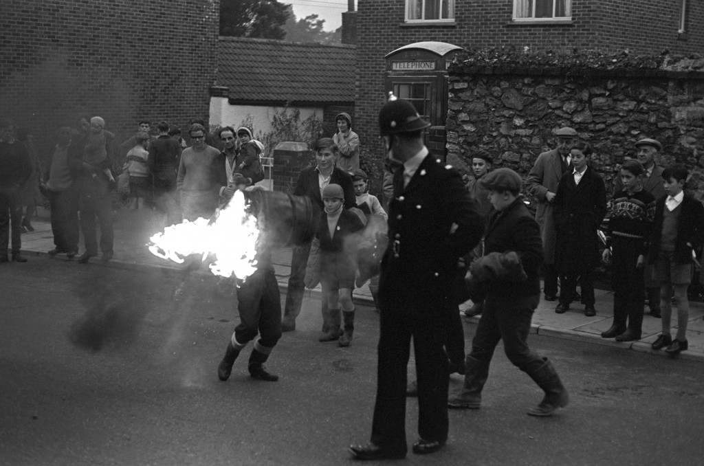 A policeman looks on as the children join in the game. PA-2277457