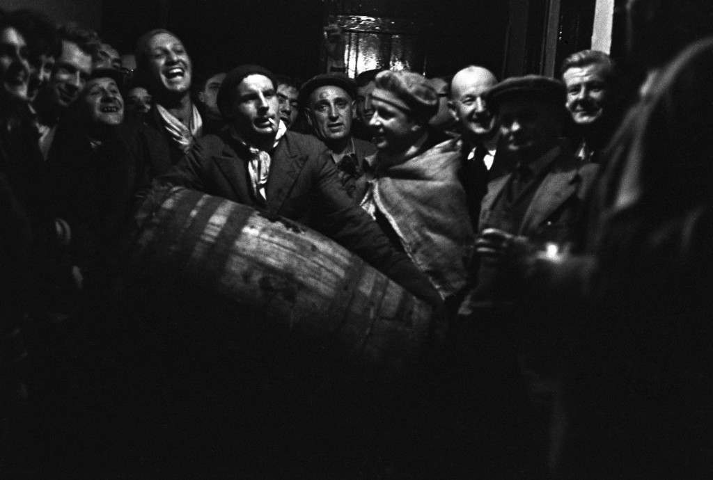 Men leaving the 'Five Bells' Inn with a barrel ready for burning. PA-2278907