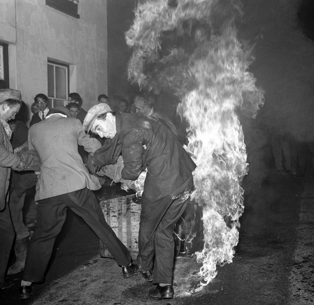 A man tried to capture a burning barrel but shouldn't have turned his back on the flames.  PA-2280266