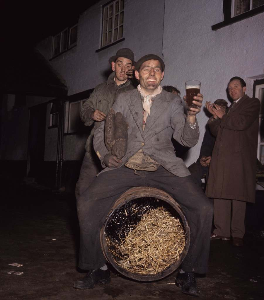 Participants enjoy a beer after the traditional tar barrel burning ceremony. PA-2280310.