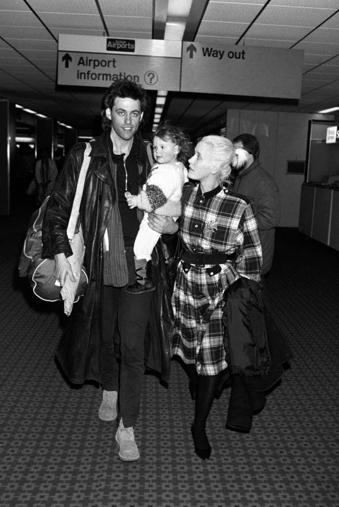 Bob Geldof arrives at Heathrow Airport, where he was greeted by his wife Paula Yates, with their daughter Fifi. Geldof had just flown in from Ethiopa and the Sudan, where he witnessed the famine on behalf of his Band Aid record. PA-2312186