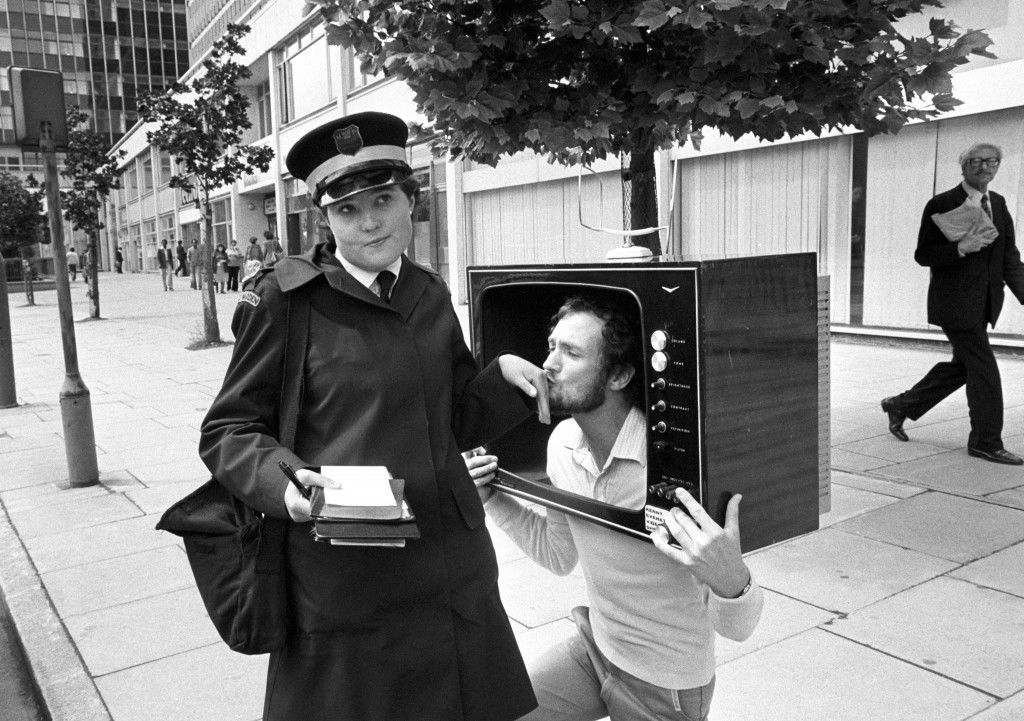 With a kiss and a look which implores traffic warden Angela Carmody, 25, of London's Southgate to watch this space, Kenny Everett was abviously out in London to woo Thames TV viewers to watch his new Video Show. Ref #: PA.2339117  Date: 22/06/1978