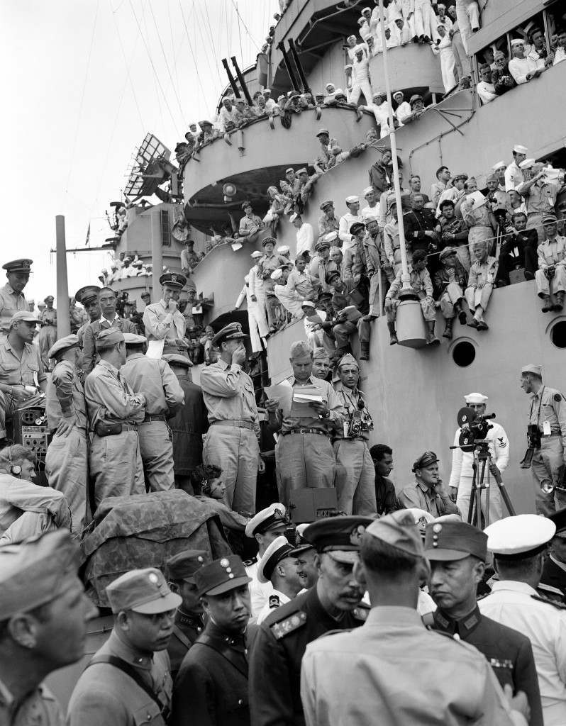 Spectators and correspondents from all over the world pick vantage positions on the deck of the USS Missouri, in Tokyo Bay, on September 2, 1945, to watch the formal Japanese surrender ceremony marking the end of World War II. (AP Photo, Frank Filan) Ref #: PA.2373534