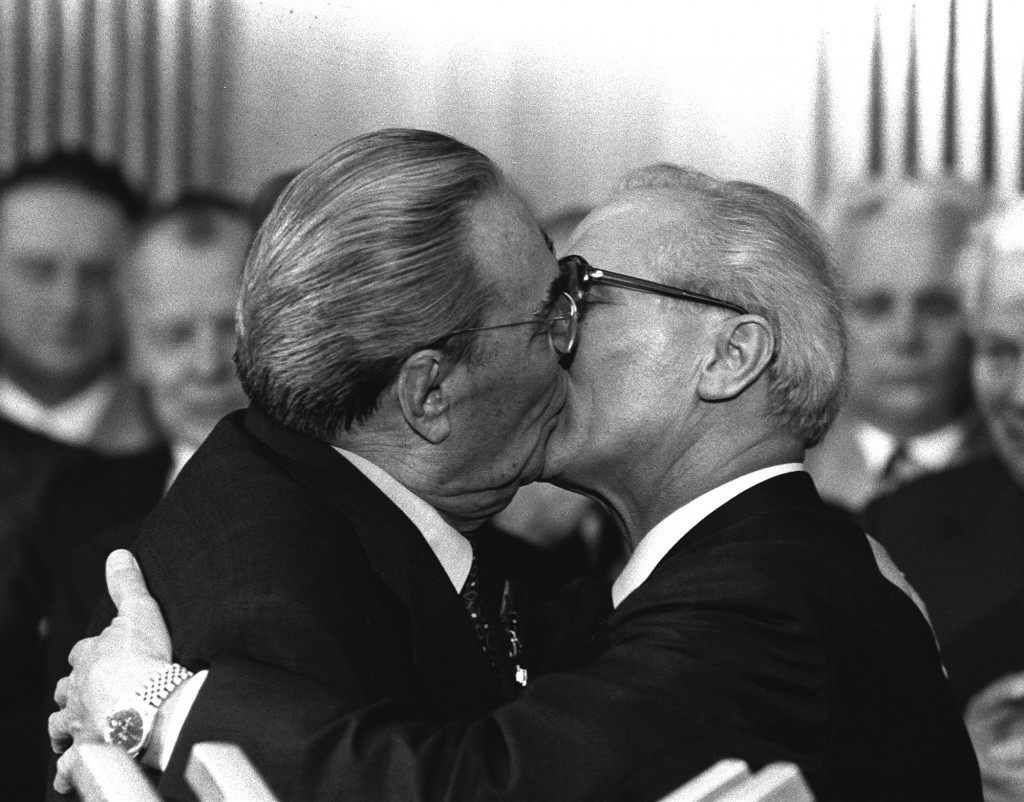 "Berlin, East Germany, Oct. 4, 1979 - Soviet President Leonid Brezhnev and East German leader Erich Honecker change kisses after Brezhnev was honored with the title ""Hero of the German Democratic Republik"" and the ""Karl Marx Medal"". Brezhnev participates in the celebrations marking the 30th anniversary of the East German State`s foundation. (AP Photo/Helmuth Lohmann/stf) Ref #: PA.2376039  Date: 04/10/1979"