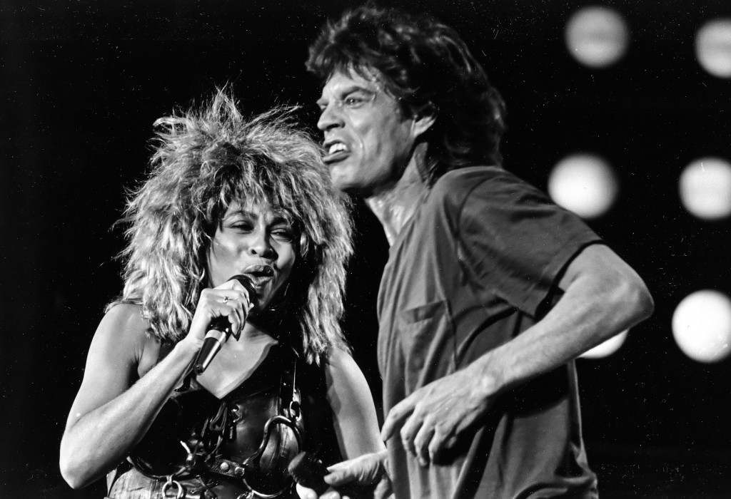 Tina Turner and Mick Jagger perform together at the Live Aid concert in Philadelphia in this July 13, 1985, file photo. The Philadelphia Inquirer reported Sunday, May 29, 2005, that two decades after rock stars descended in Philadelphia to raise funds for Africa, a sequel is coming to the city. Singer-activist Bob Geldof is again organizing the event, to be held on July 2. Details are expected to be announced Tuesday during joint news conferences planned for Philadelphia and London. (AP Photo/Rusty Kennedy) PA-2423979