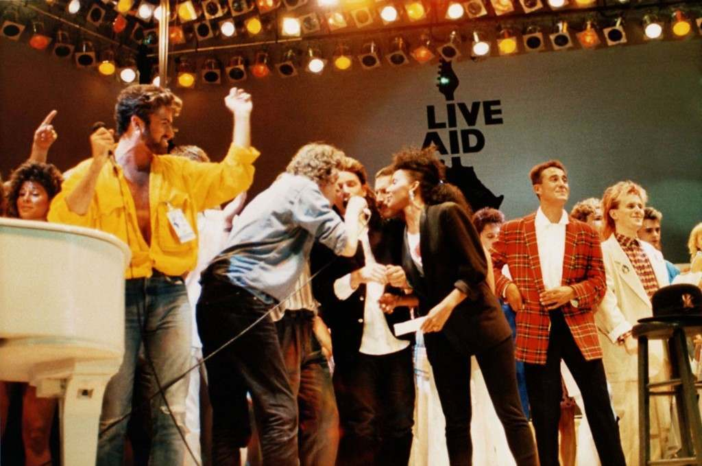 British and Irish singers perform on stage at the Live Aid concert at Wembley Stadium, London, England, on July 13, 1985. From left are George Michael of Wham, Bob Geldolf, Bono of U2, Freddie Mercury of Queen, Andrew Ridgley of Wham! and Howard Jones. It may be hard for next month's Live 8 concert to be as historic or even heart-warming as the 1985 Live Aid show, one of the greatest rock concerts of all time. (AP Photo) PA-2443361