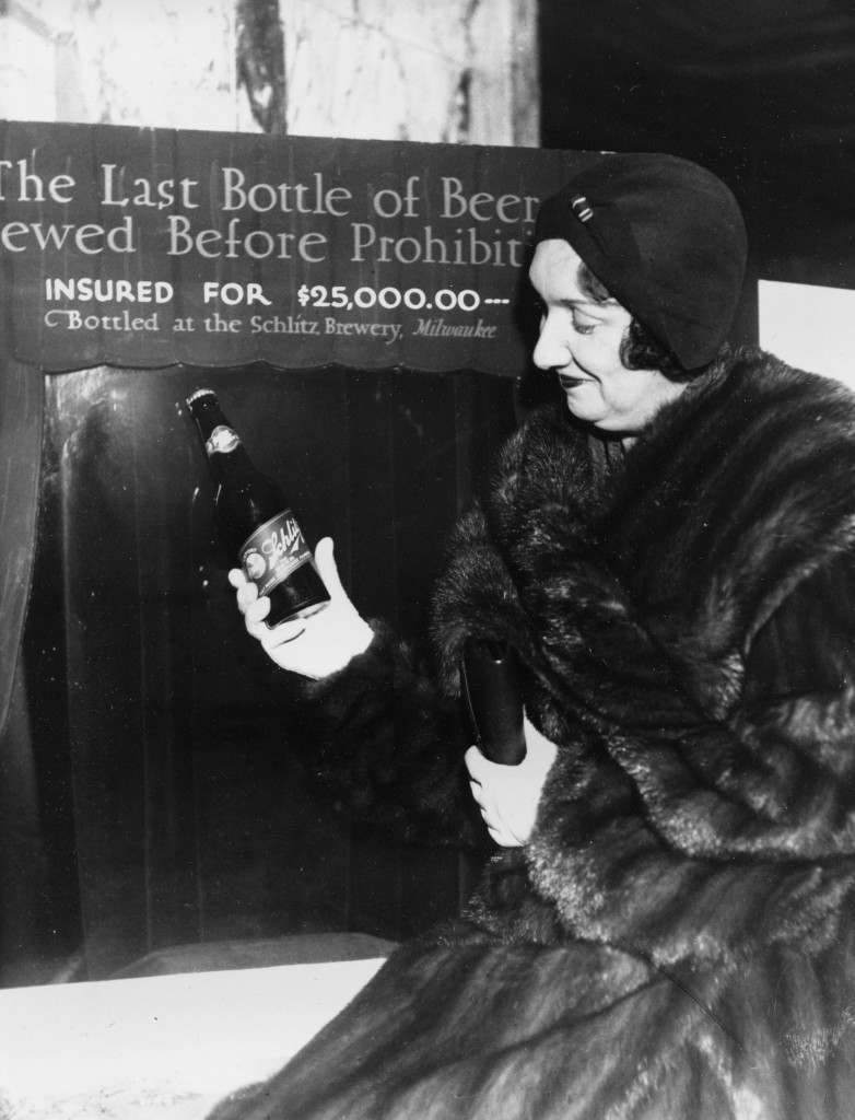 Rae Samuels holds the last bottle of beer that was distilled before prohibition went into effect in Chicago, Ill., Dec. 29, 1920. The bottle of Schlitz has been insured for $25,000. Ref #: PA.2470949  Date: 29/12/1930