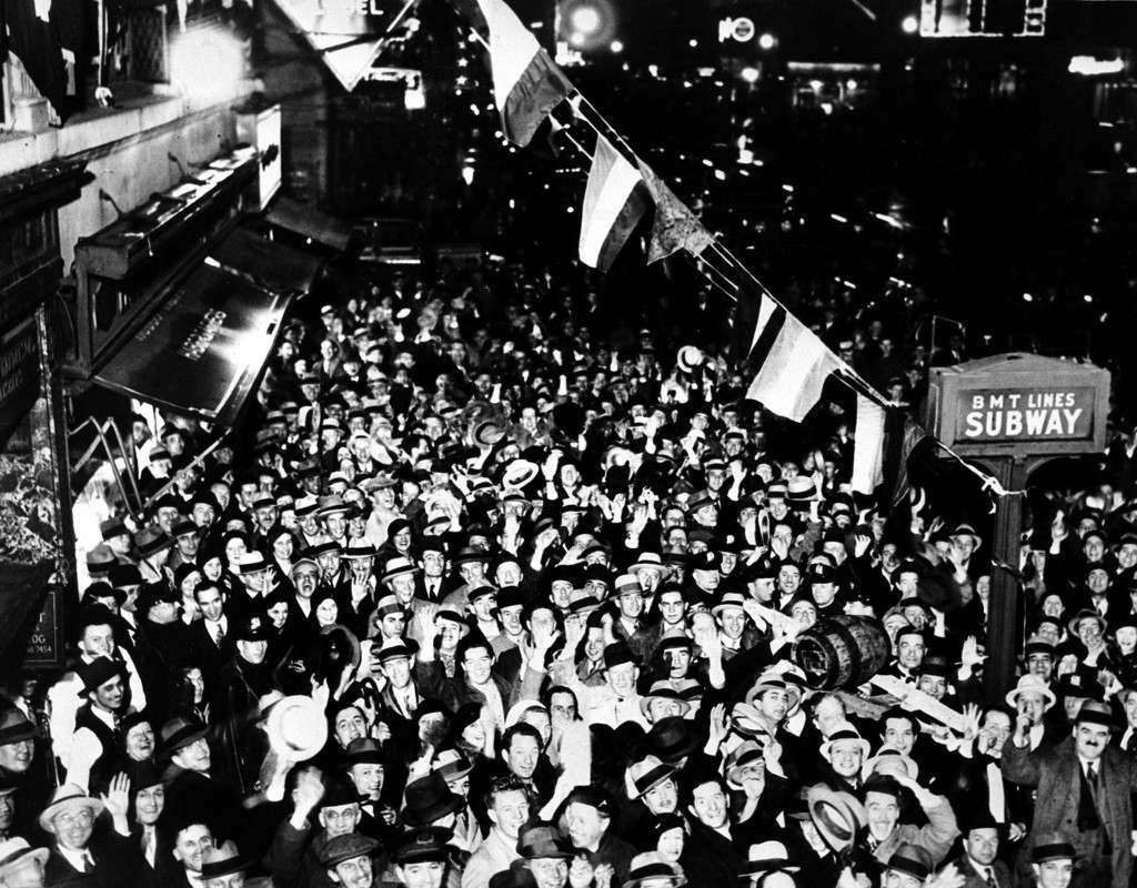 A crowd gathers on Broadway to celebrate the repeal of prohibition after midnight in New York City, April 7, 1933. A beer keg is held aloft at right. Ref #: PA.2483836  Date: 07/04/1933