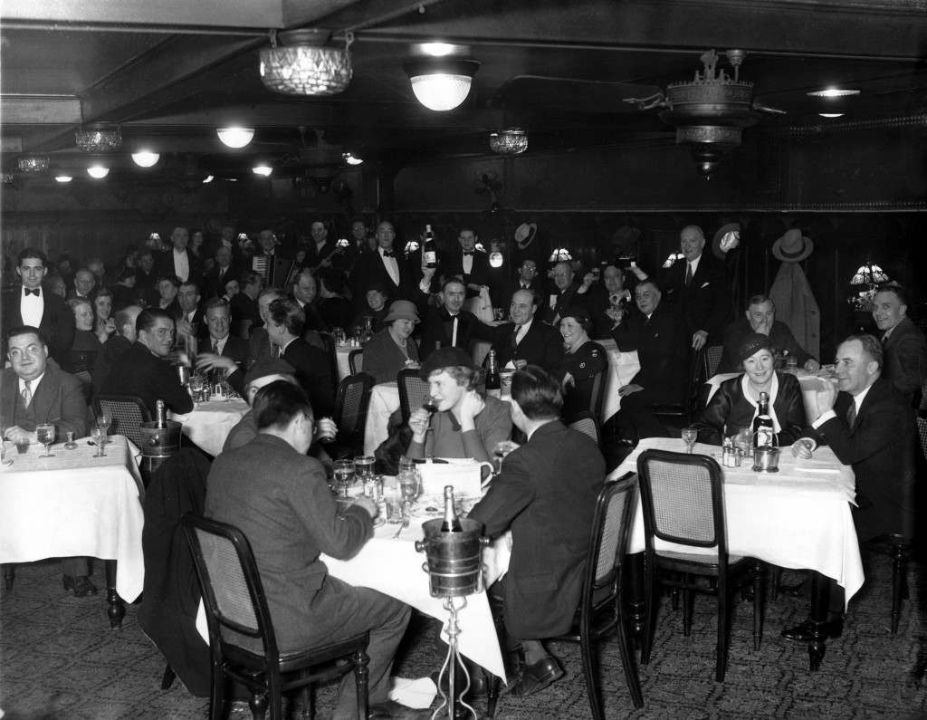 People enjoy legal drinking as they gather at Cavanagh's in New York City on Dec. 5, 1933 after the 21st Ammendment is ratified. Ref #: PA.2483870 Date: 05/12/1933