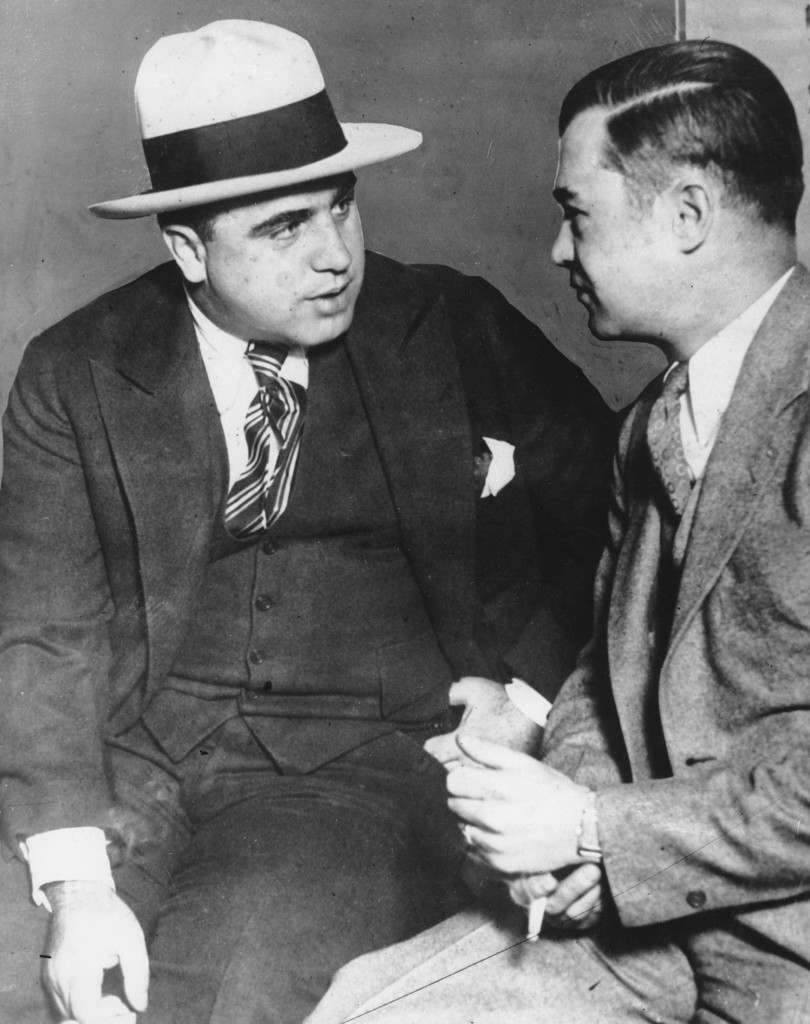 Al Capone, called before a grand jury, talks to a man in Chicago, Ill. March 21st, 1929. Capone was charged with tax evasion in 1931 and sentenced to 10 years in prison Ref #: PA.2484235  Date: 21/03/1929