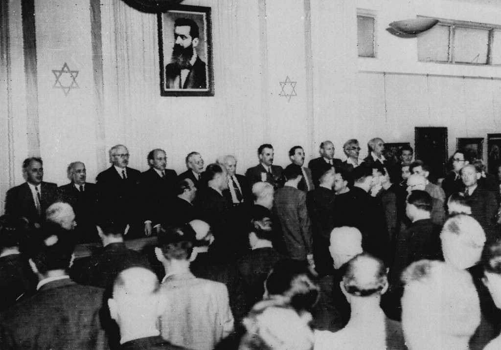 "Cabinet Ministers of the new state of Israel sing ""Hatikvah,"" the Jewish National Anthem, May 14, 1948, at a ceremony at the Tel Aviv Art Museum, marking the creation of the new state. Facing Camera from left are: Baroch Shitrit, Police Commissioner; David Remez, Communications Minister; Fritz Bernstein, Trade, Industry and Suppply; Felix Rosenbluth, Justice; Rabbi Judah Fishman, Commissioner of Jerusalem Area, David Ben Gurion, Premier and Defense Minister; Moshe Shapiro, Director of Immigation; Moshe Shertok, Foreign Afairs; Eliazer Kaplan, Treasurer; Moshe Ben Tov, Public Works and Labor; and Aaron Zisling, Agriculture. (AP Photos/Files) Ref #: PA.2580791 Date: 14/05/1948"
